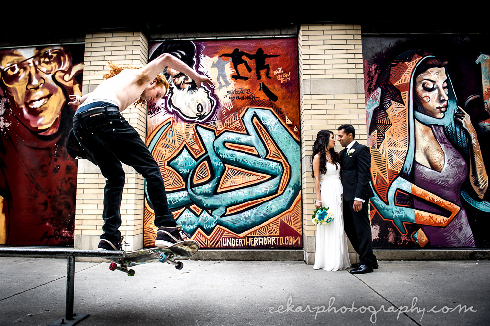 bride and groom with skateboarding dude