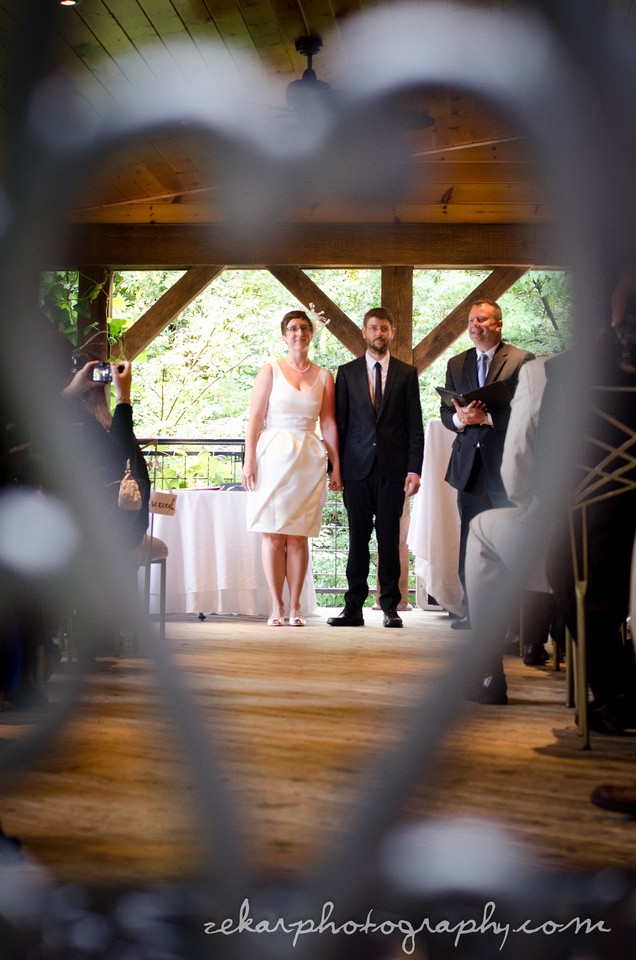 bride and groom through heart