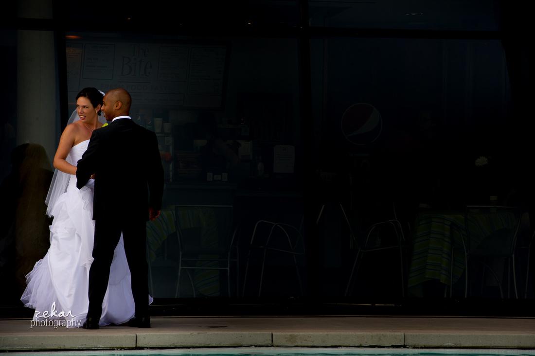 bride and groom looking backwards