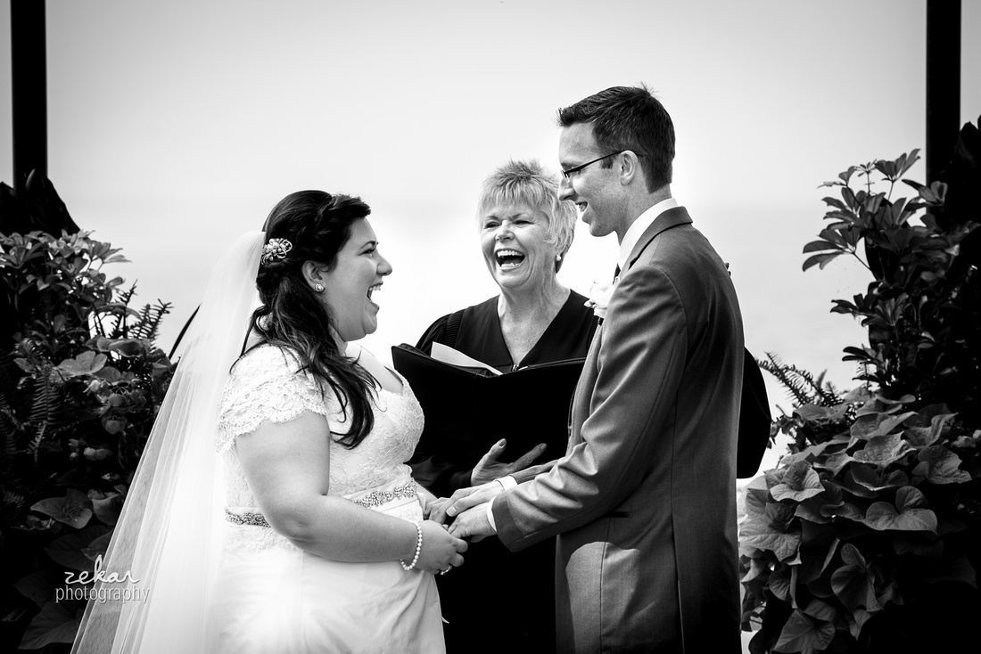 laughing couple at wedding ceremony