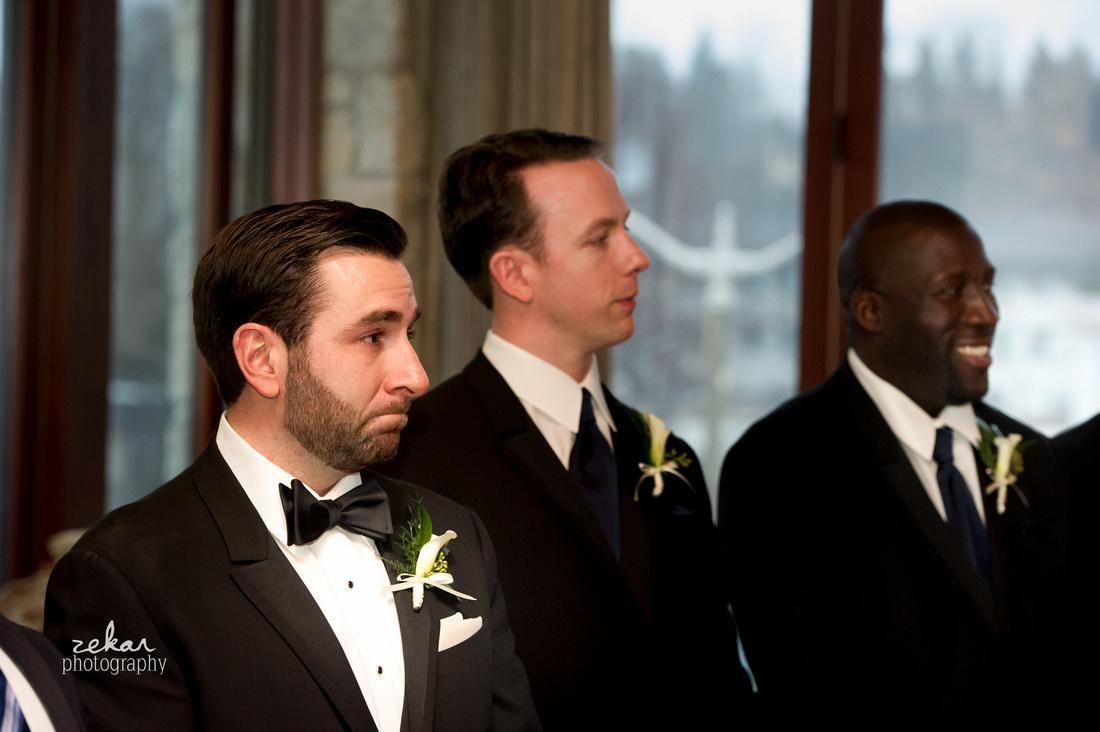 groom crying as wife walks down aisle