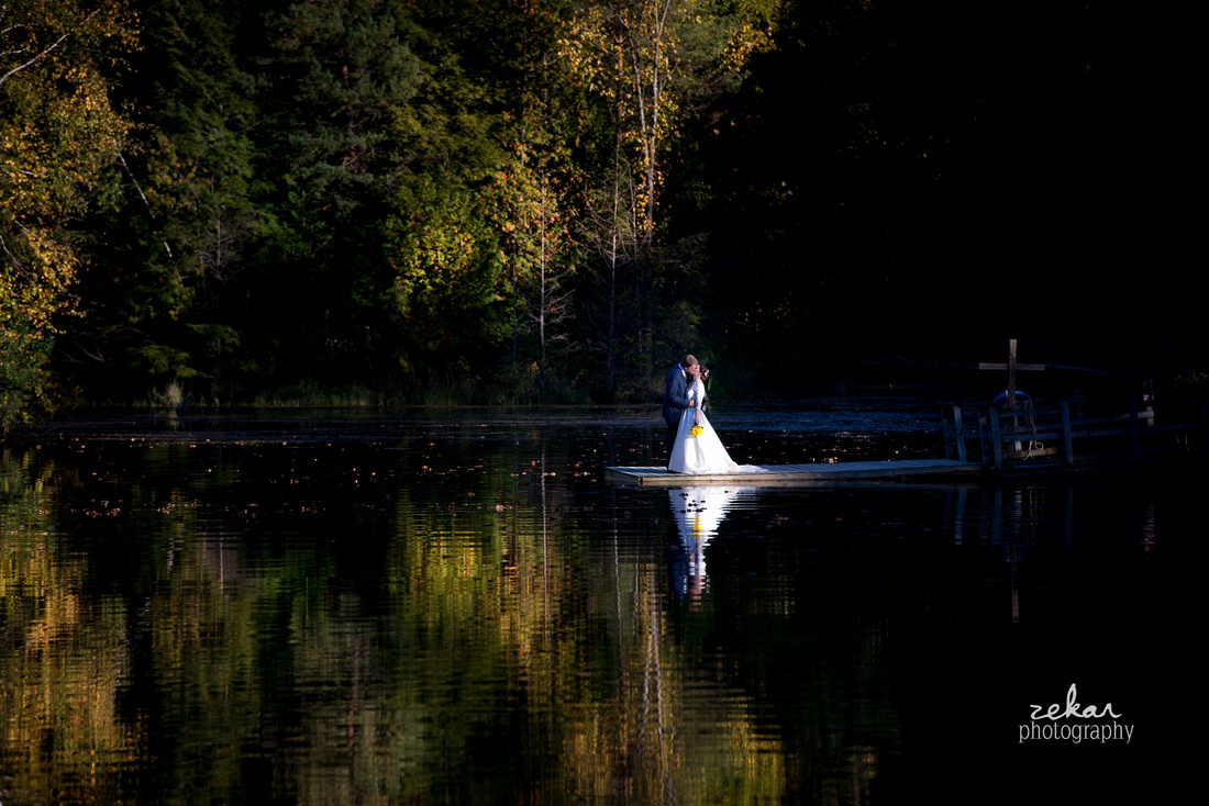 kissing on lake woods autumn