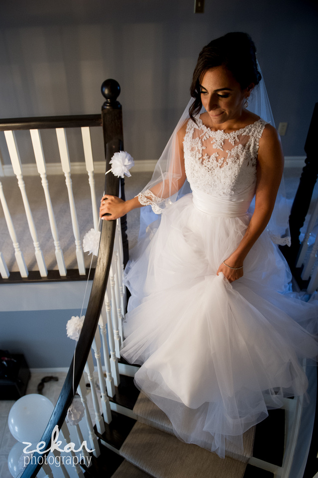 bride walking down stairs to see her dad