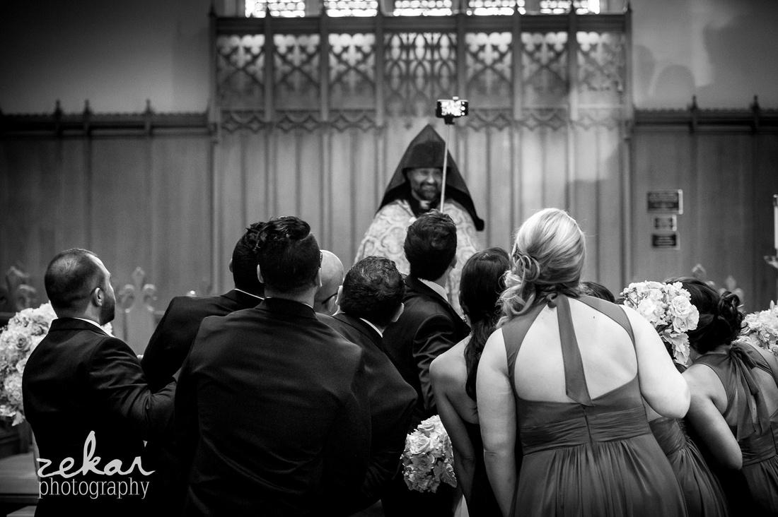 bridal party taking selfie at altar