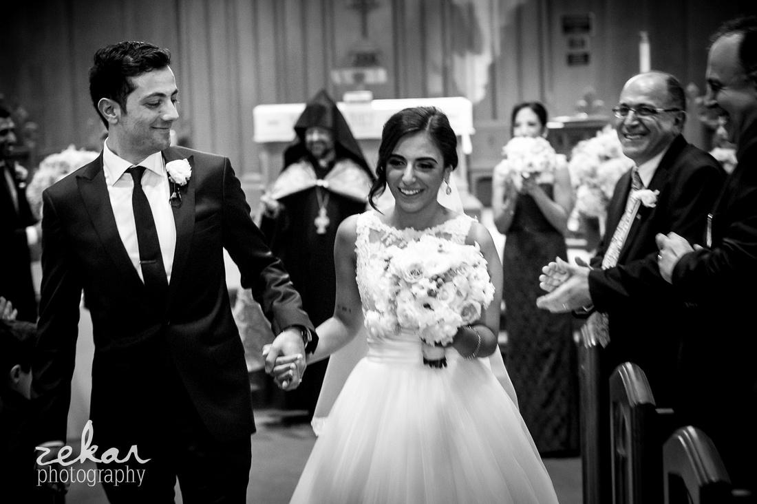 happy couple walking down aisle