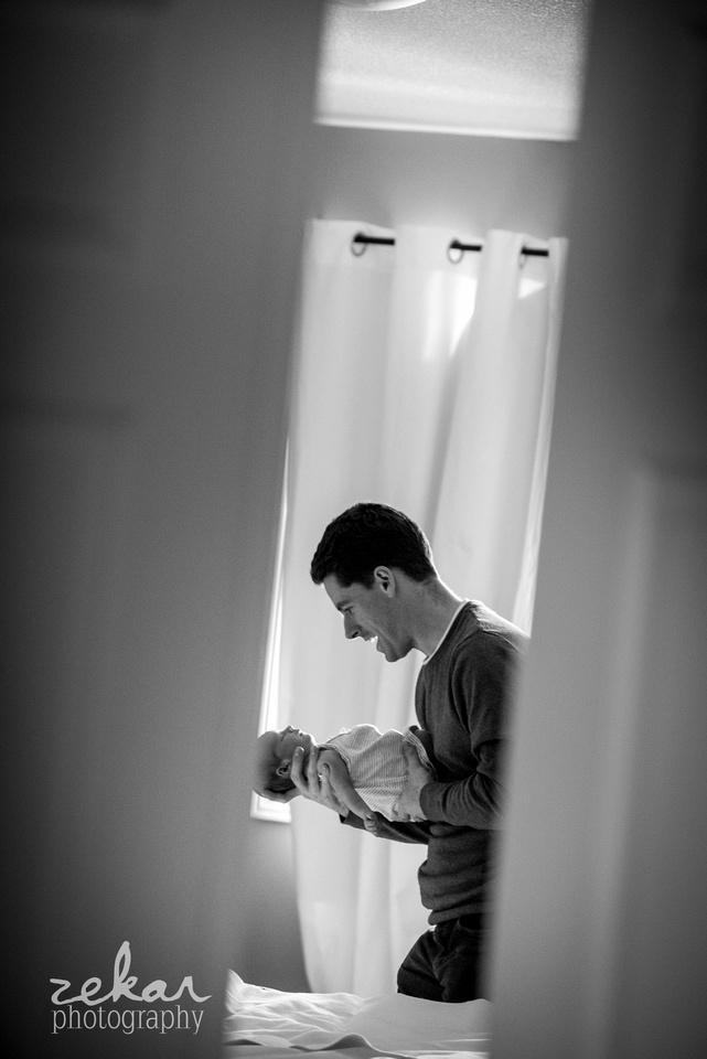 dad holding newborn baby girl