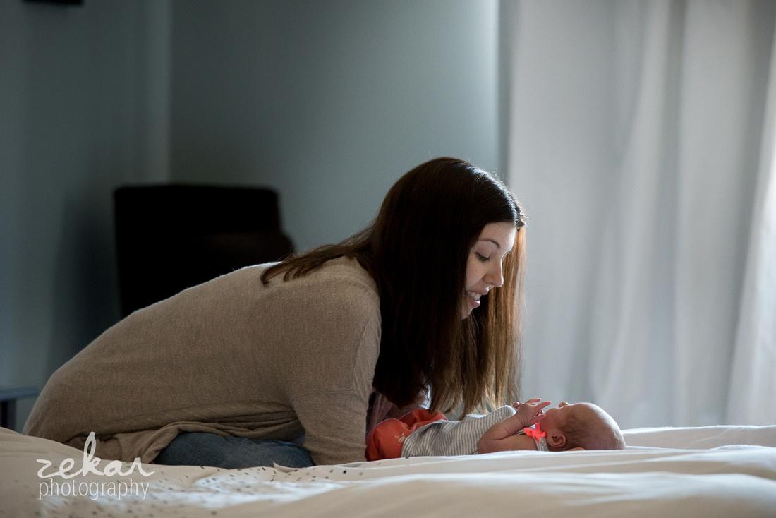 mom looking at newborn baby