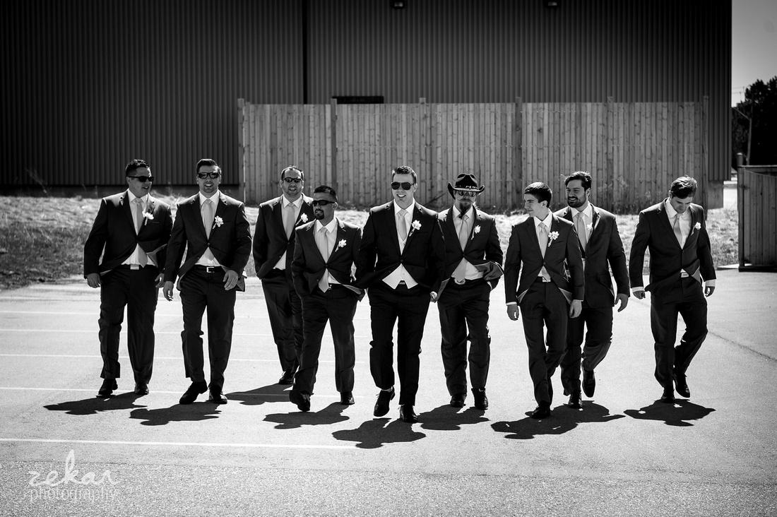 groomsmen walking across parking lot