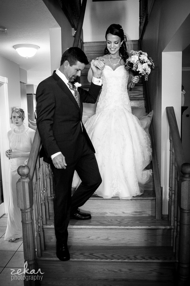 dad helping bride come down stairs