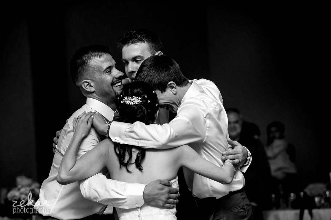 brothers groom bride hugging