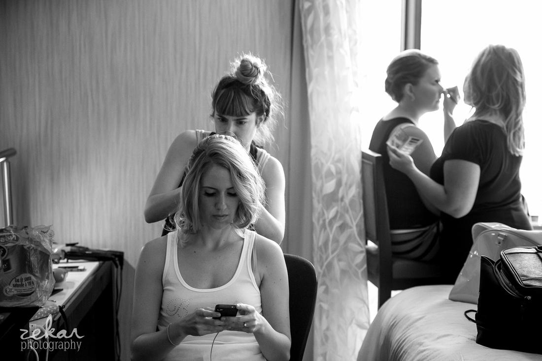 bride texting getting ready
