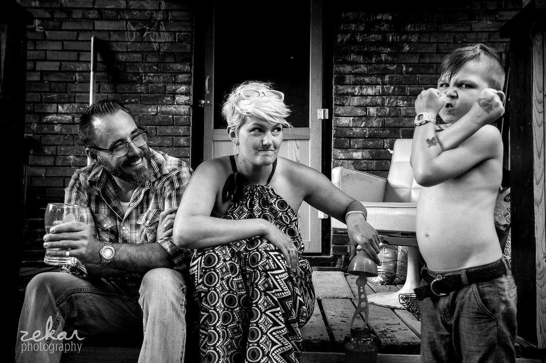 parents joking around with little boy