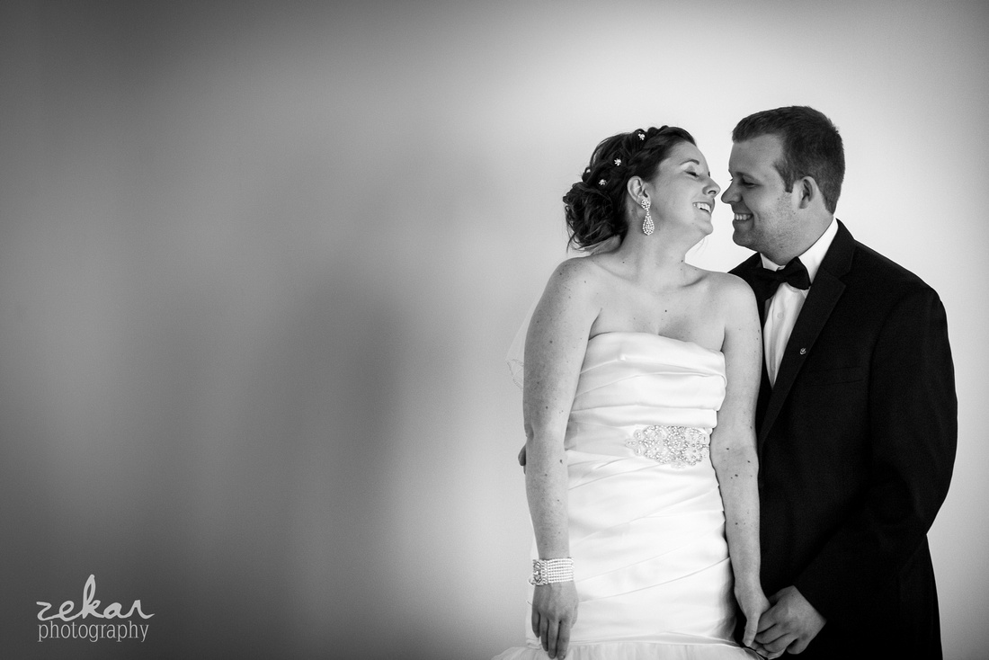 bride and groom laughing with eachother
