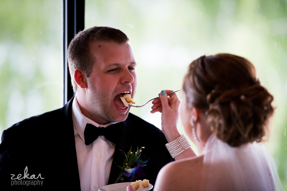 bride feeds cake to groom