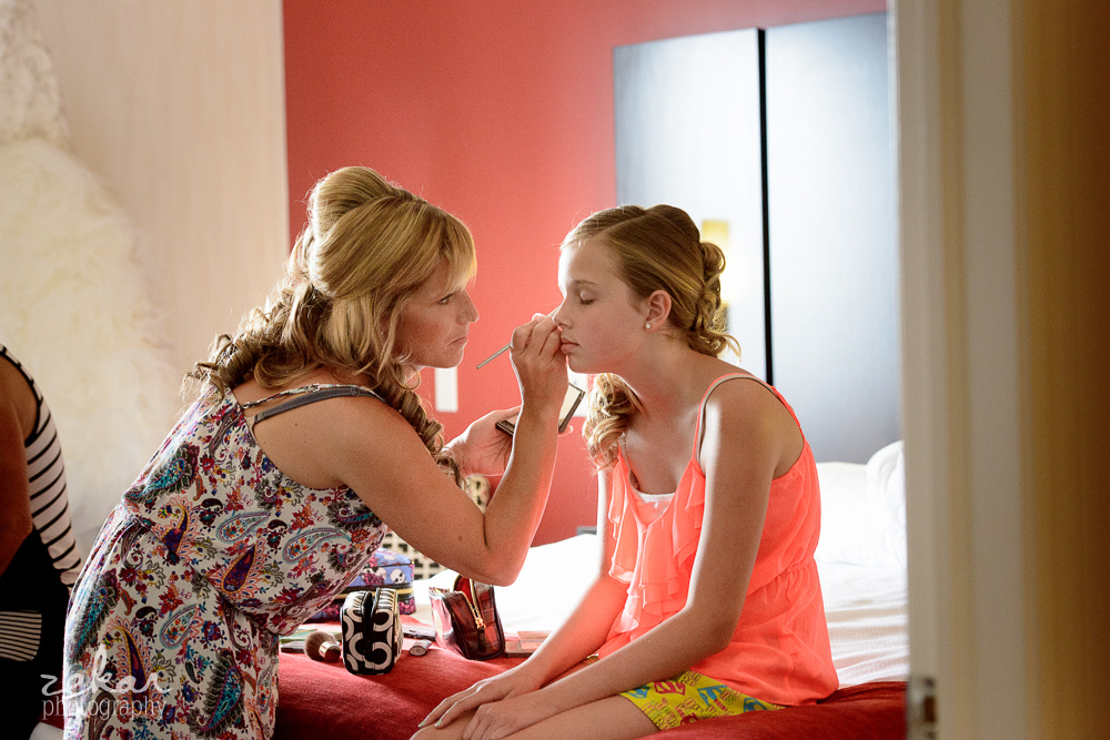 mom gets daughter ready on wedding day