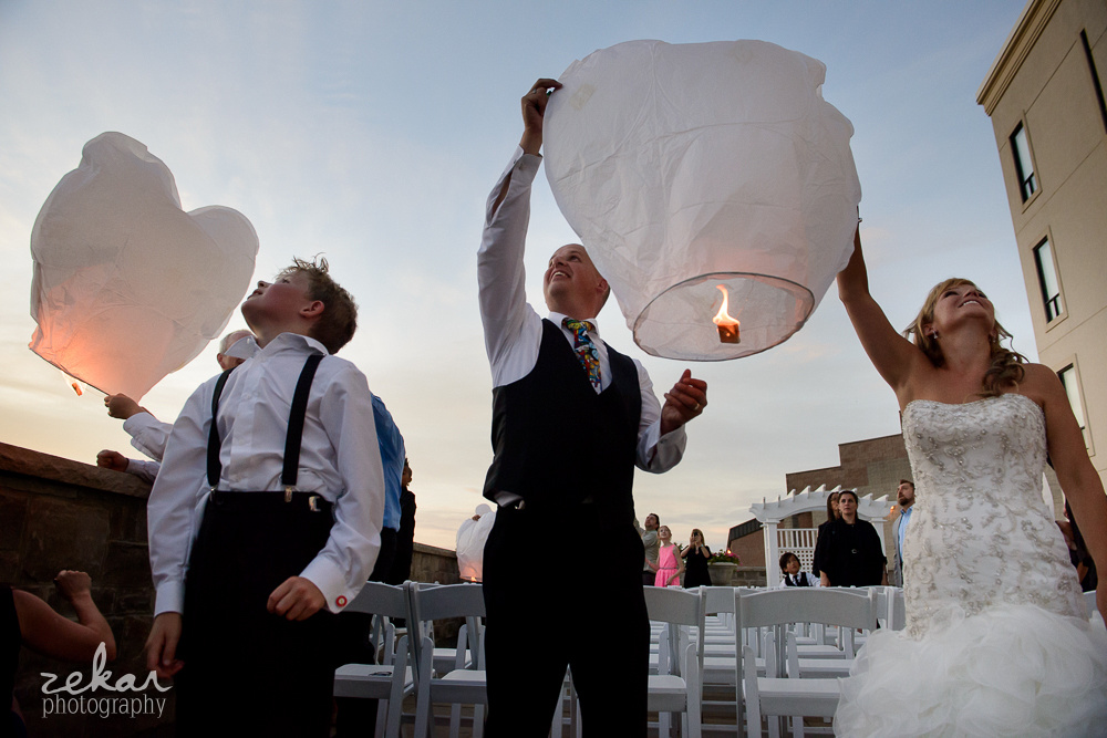 bride and groom holding chinese lanterns