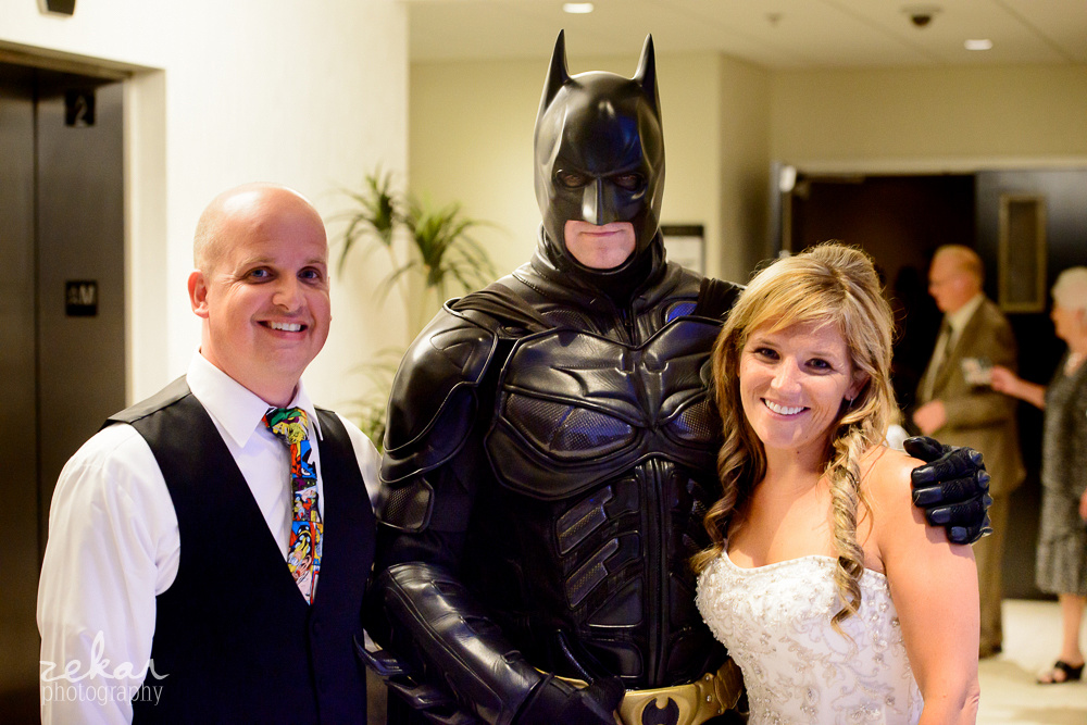bride and groom pose with batman