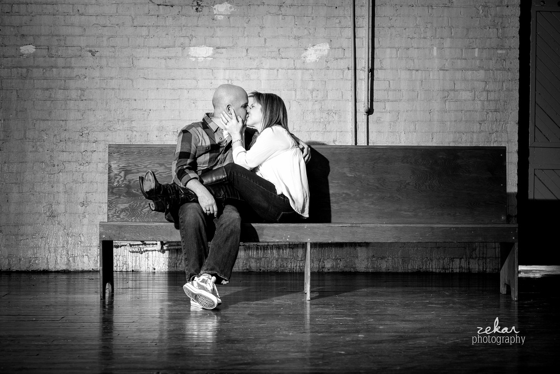 black and white couple on antique bench engagement shoot
