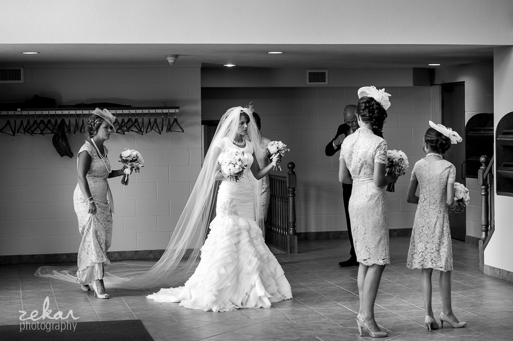 bride getting ready to go down aisle
