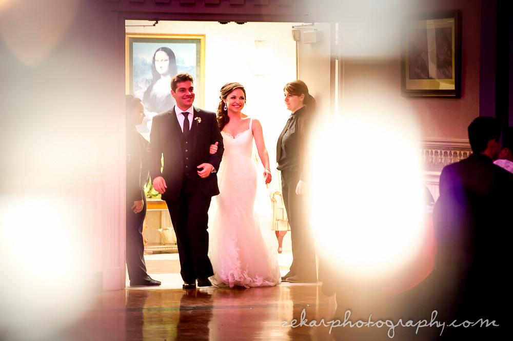 bride and groom entering reception hall