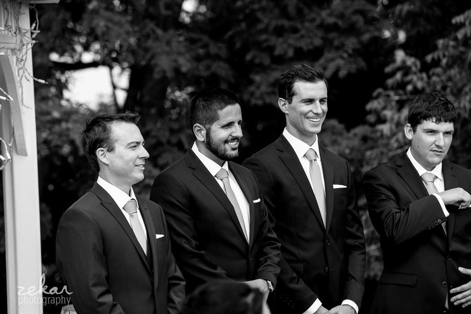 groomsmen waiting for bride