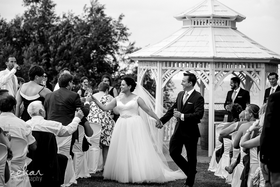 bride and groom cheers guests