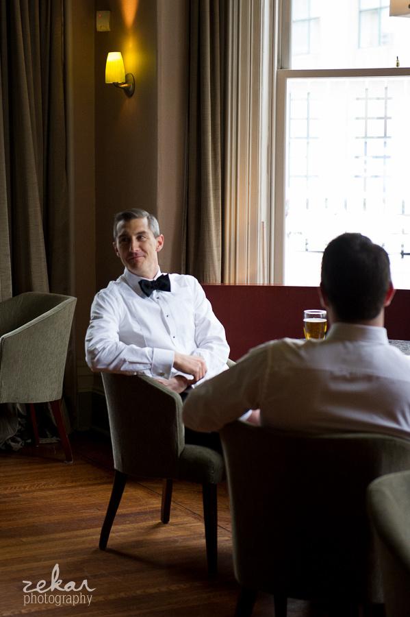 groom drinking beer