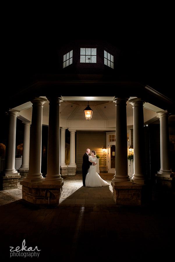 bride and groom under gazebo