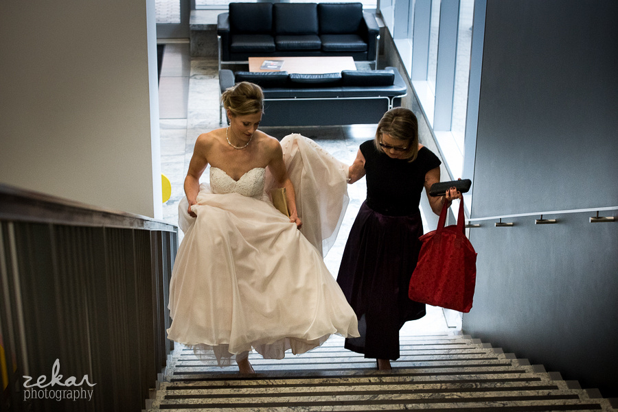bride and mom walking up stairs