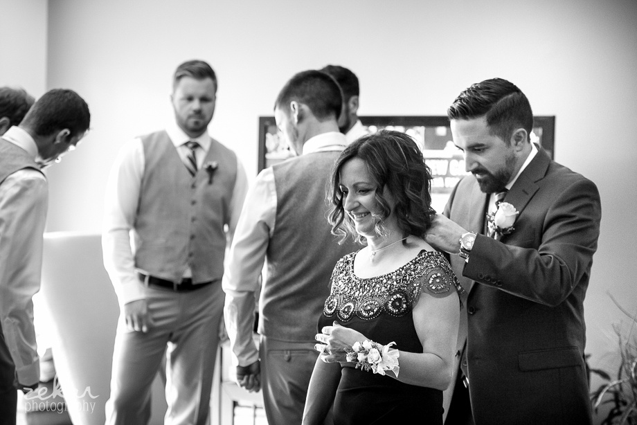 groom putting moms necklace on