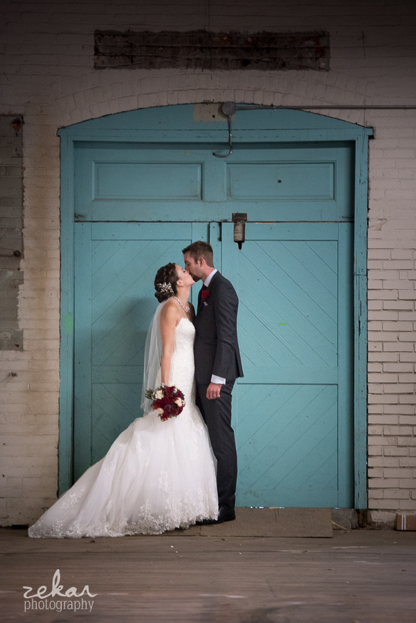 bride and groom blue wall