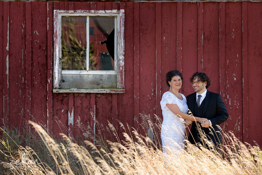 two people by barn