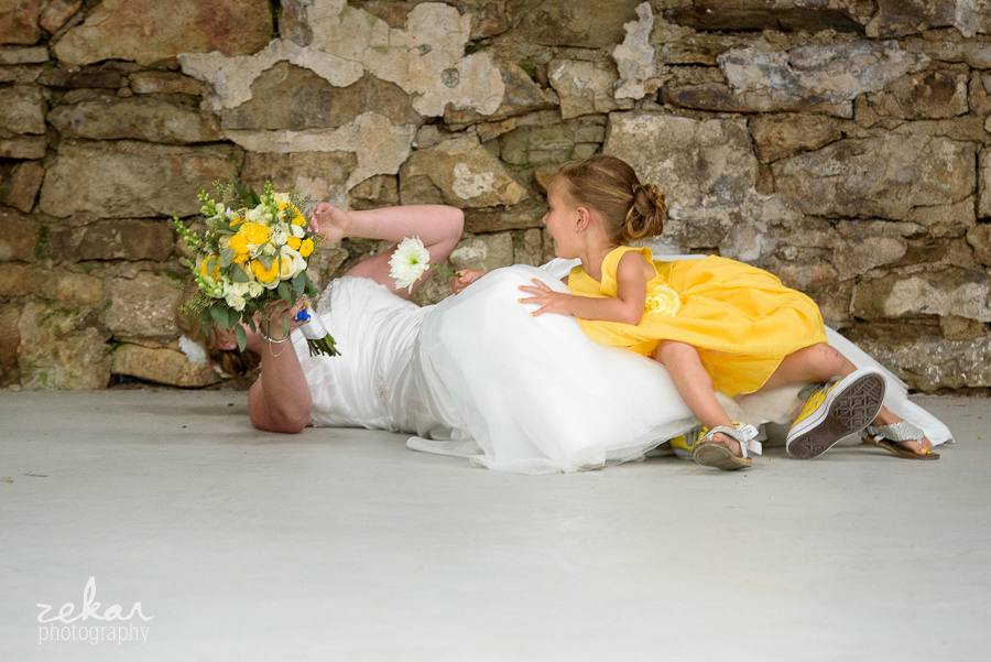 bride falls with flower girl
