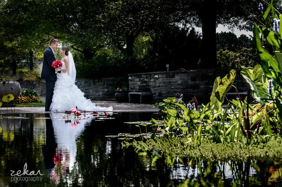 bridal couple next to koi pond