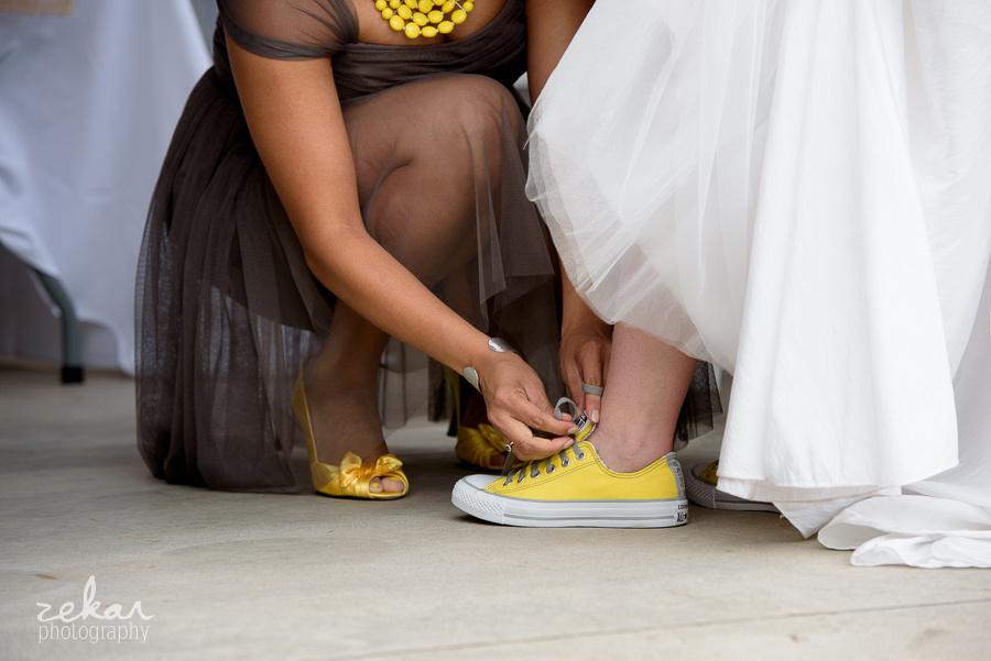 bridesmaid tying shoe