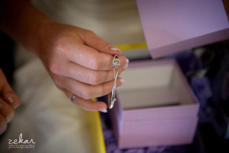 bride looks at jewellery