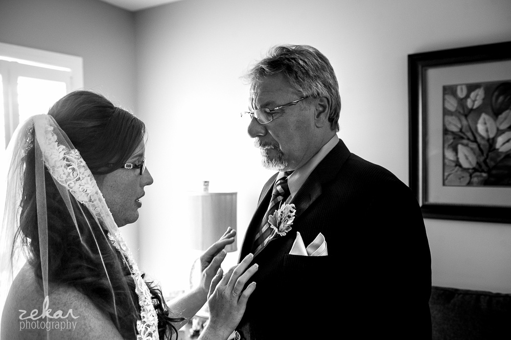 bride doing up dads corsage