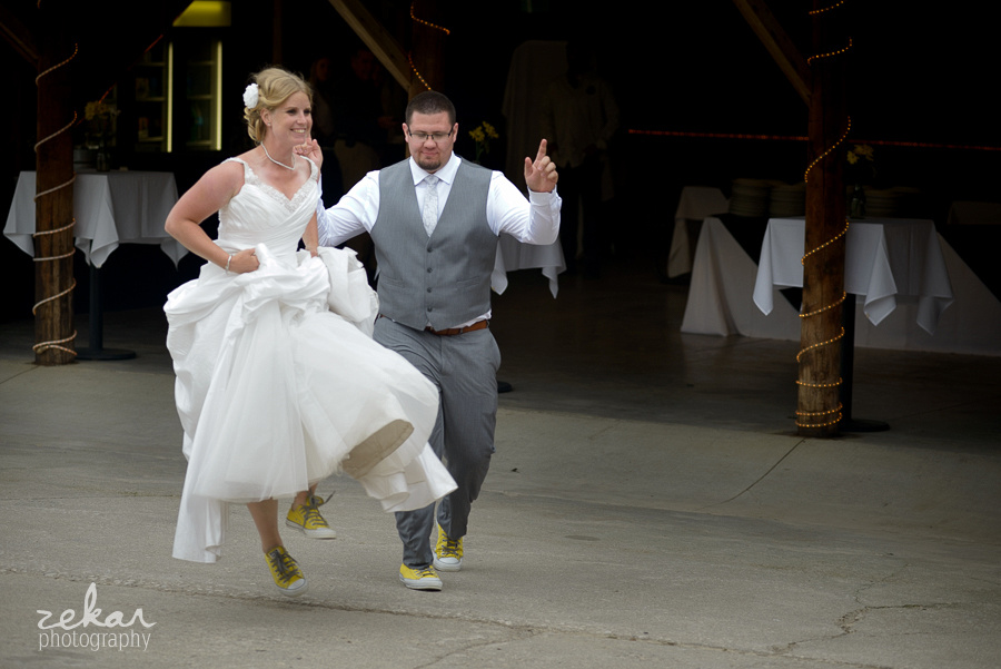 bride and groom skipping into entrance
