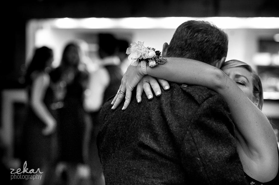mom hugging husband on wedding day