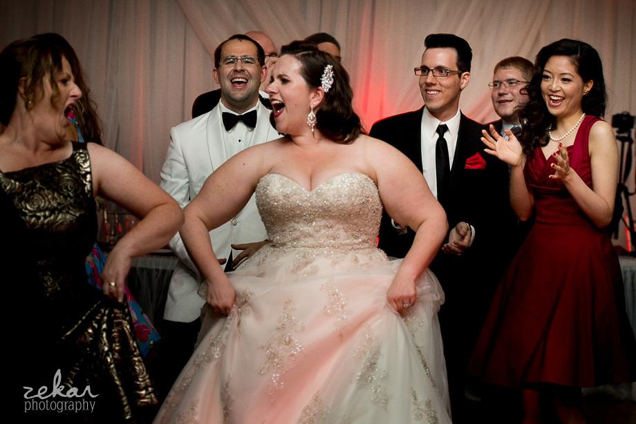 bride and mom singing