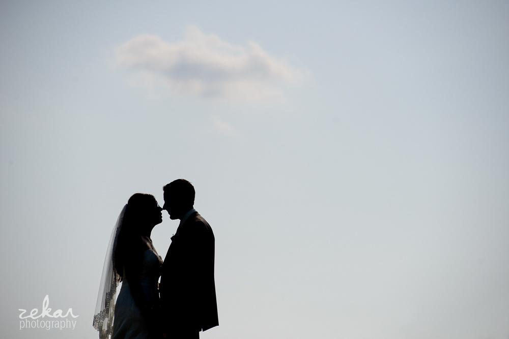 couple kissing under cloud