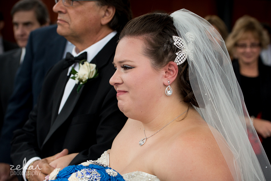 bride crying down aisle