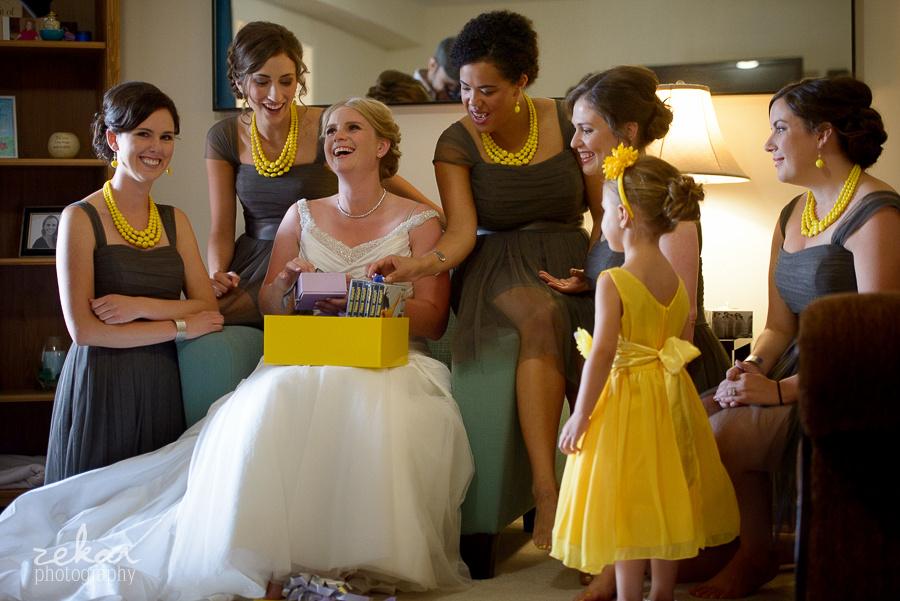 bride laughing at bridesmaids gift