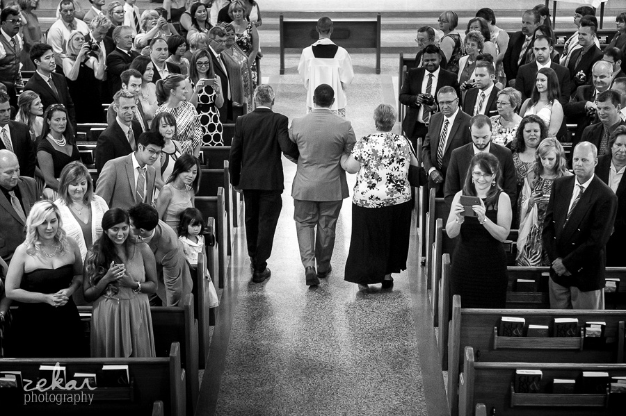 wedding guests looking down aisle to see bride