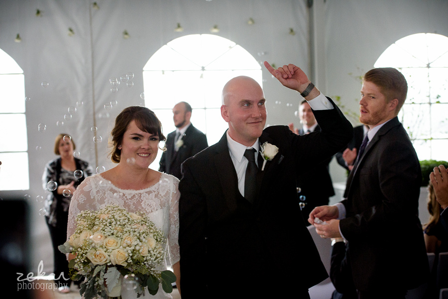 walking down aisle with bubbles