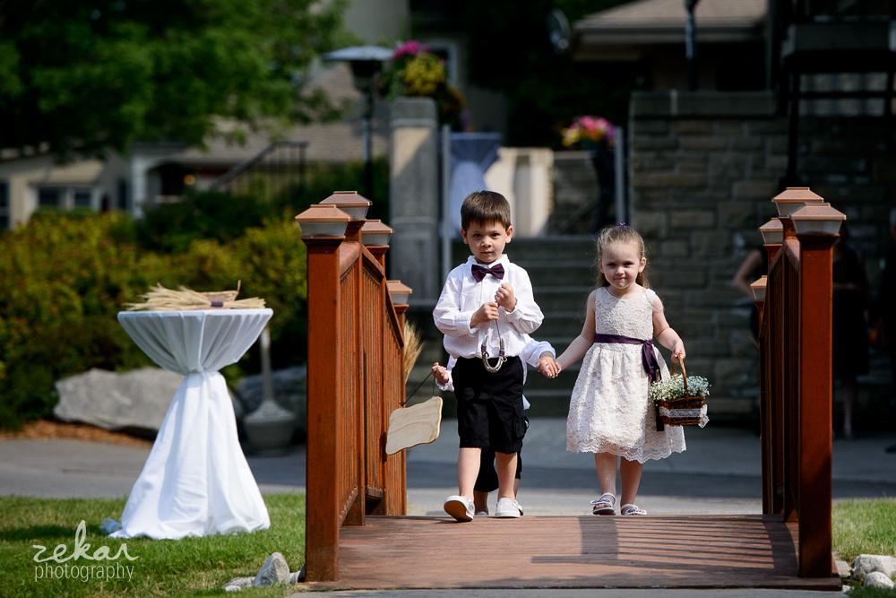 flower kids walking over bridge
