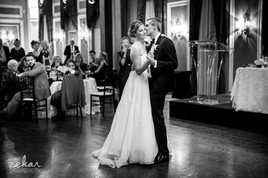 black and white photo of bride and groom dancing
