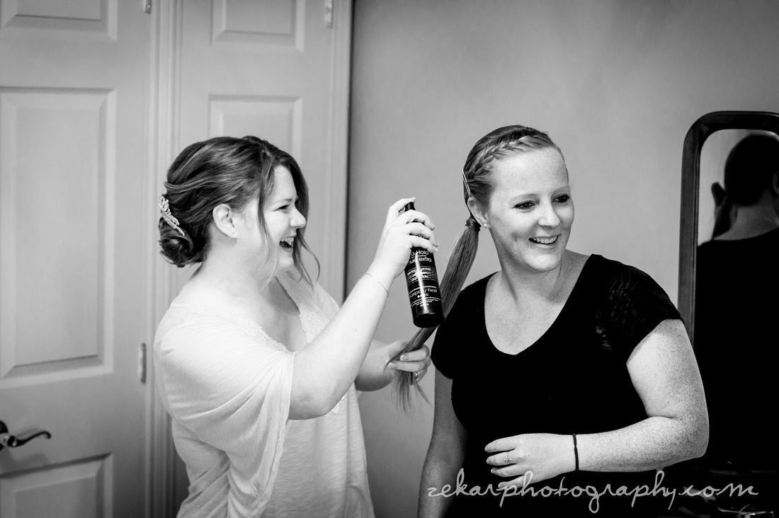 bride with hairspray bridesmaid