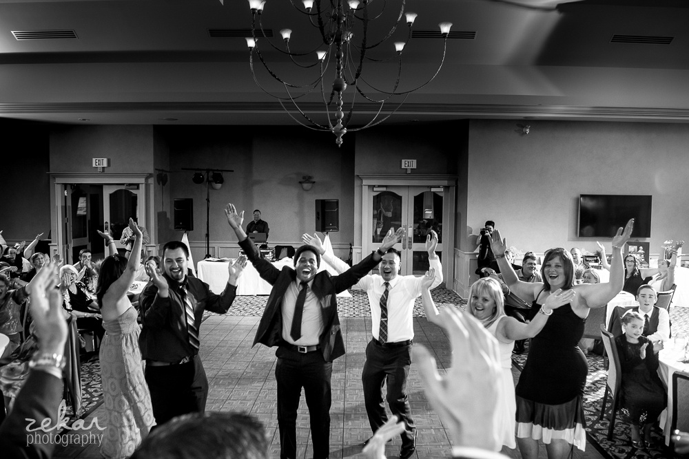 friends dancing in front of wedding table