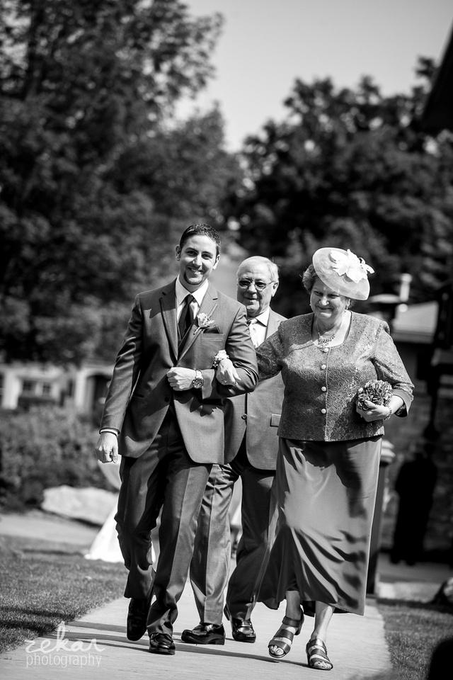 groom walking down the aisle
